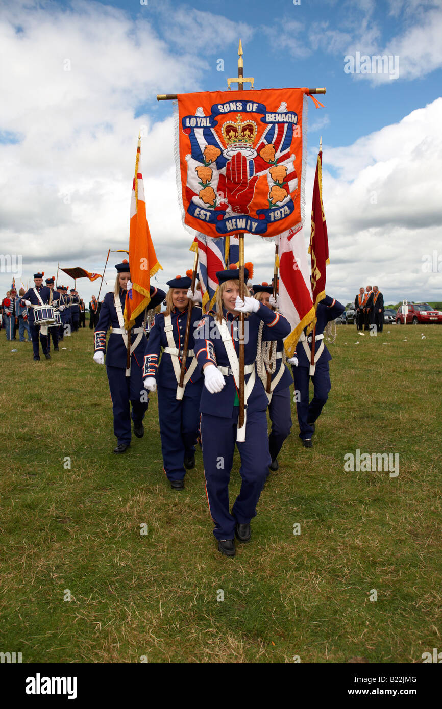 female standard carriers for loyalist flute band during 12th July Orangefest celebrations in Dromara county down - Stock Image