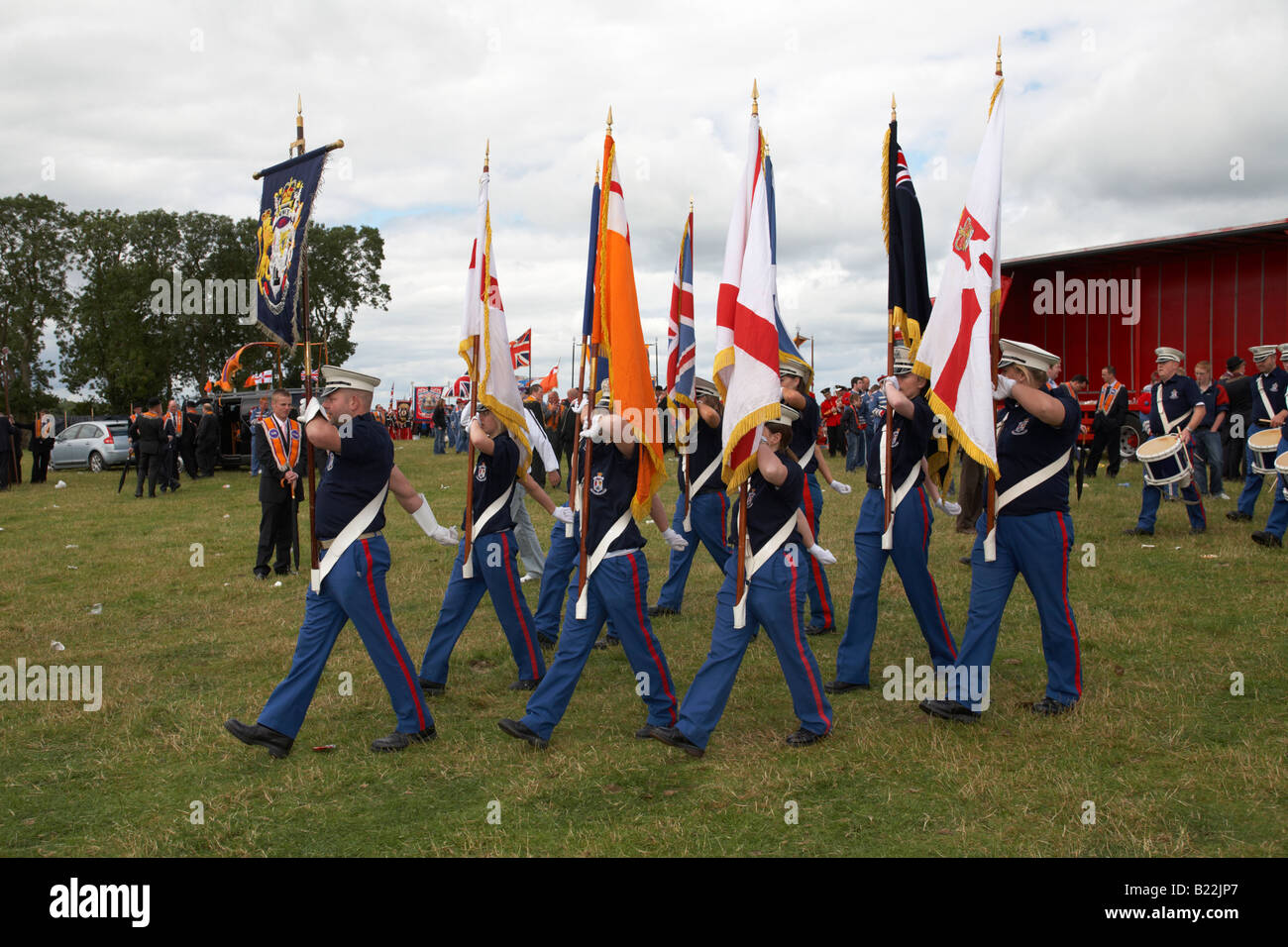 loyalist flute band colour party parade from the field during 12th July Orangefest celebrations in Dromara county - Stock Image