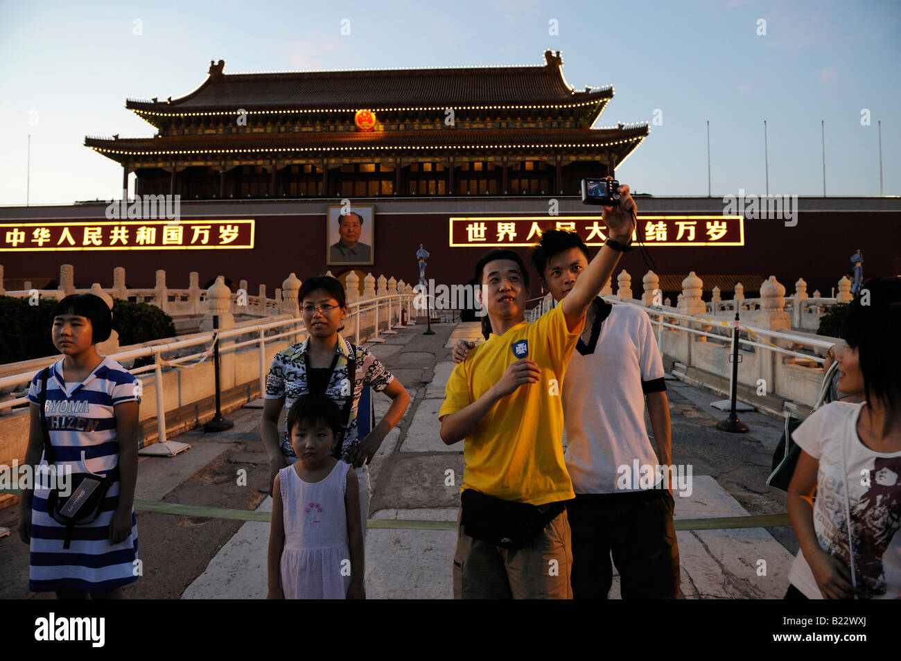 Chinese tourists take photos in front of Tiananmen Gate in Beijing China 12 Jul 2008 - Stock Image