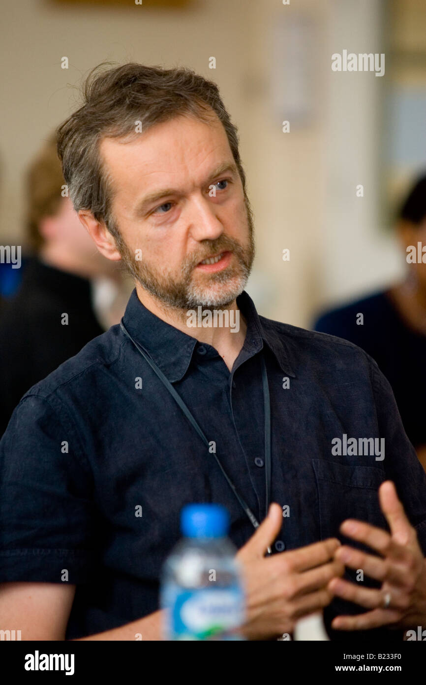 Male expresses his opinion at a conference - Stock Image