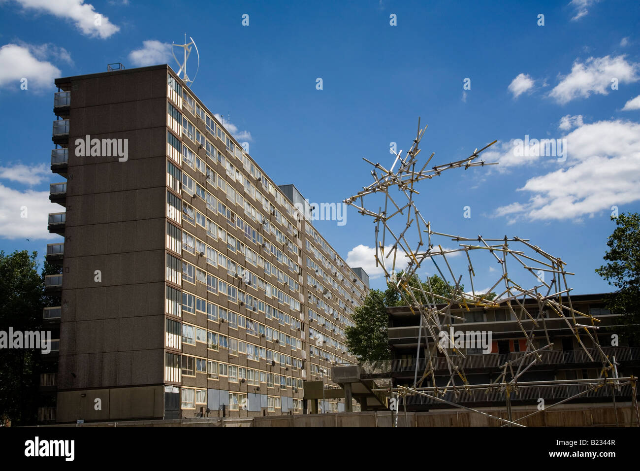 Vertical Axis Wind Turbine on top of a Council Estate in South London England Britain UK - Stock Image