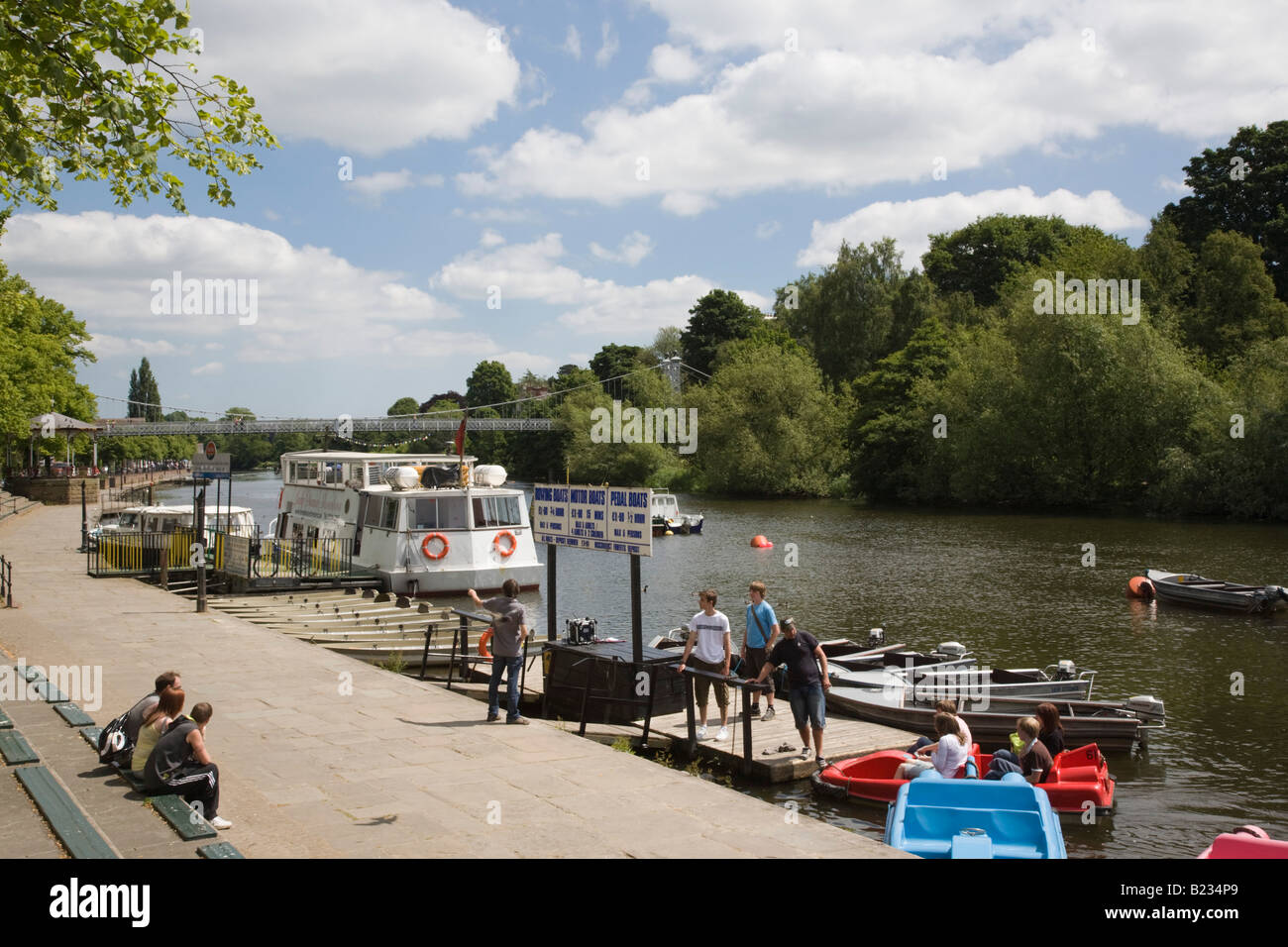 Showboat on River Dee with hire boats and people on riverbank in summer. Chester Cheshire England UK Stock Photo