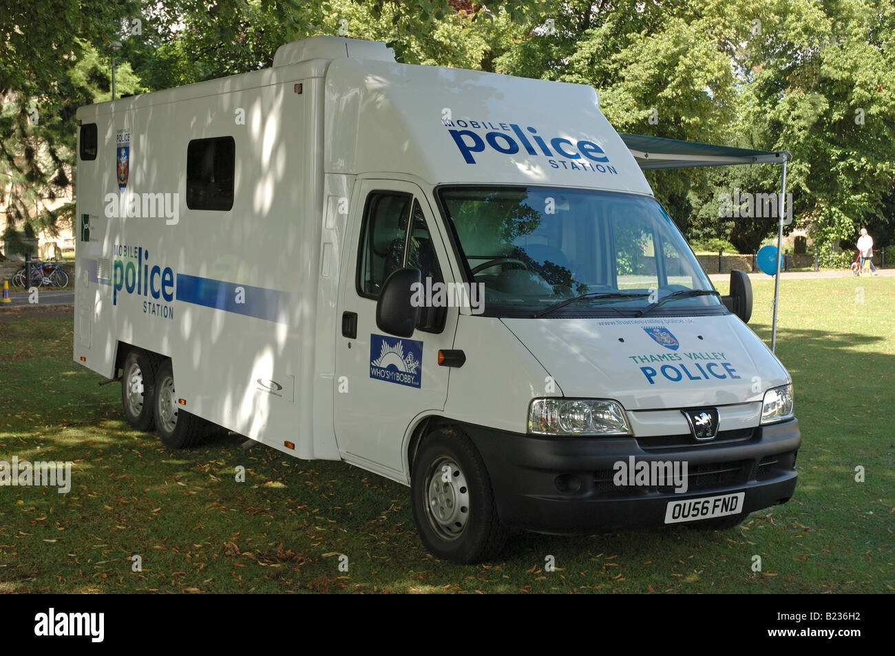Mobile police van parked in a field - Stock Image
