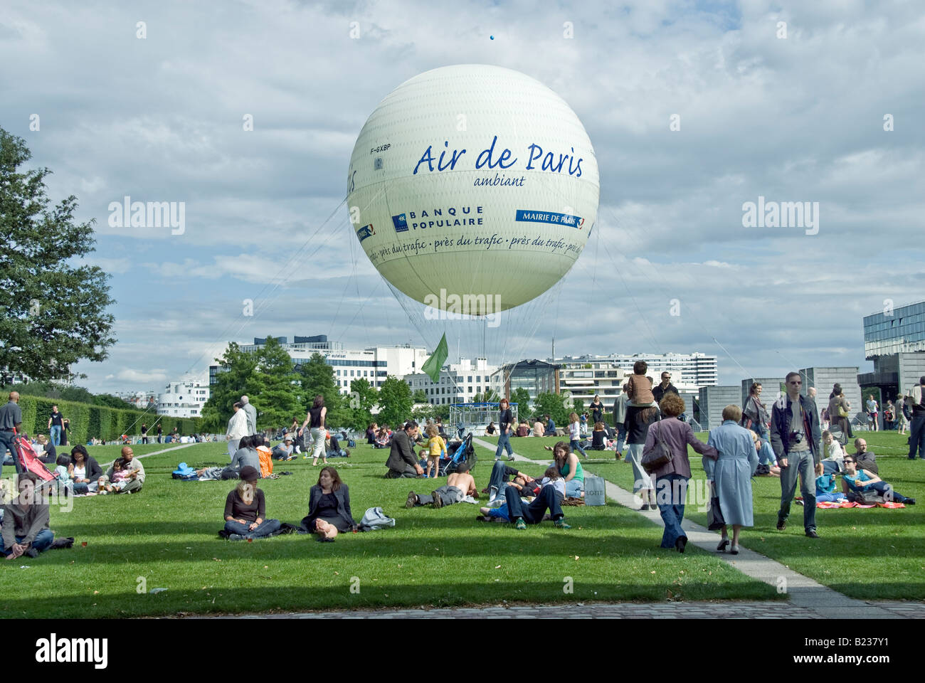 Paris France, People 'relaxing in the garden' in 'André Citro-en Park' 'Helium Balloon' - Stock Image