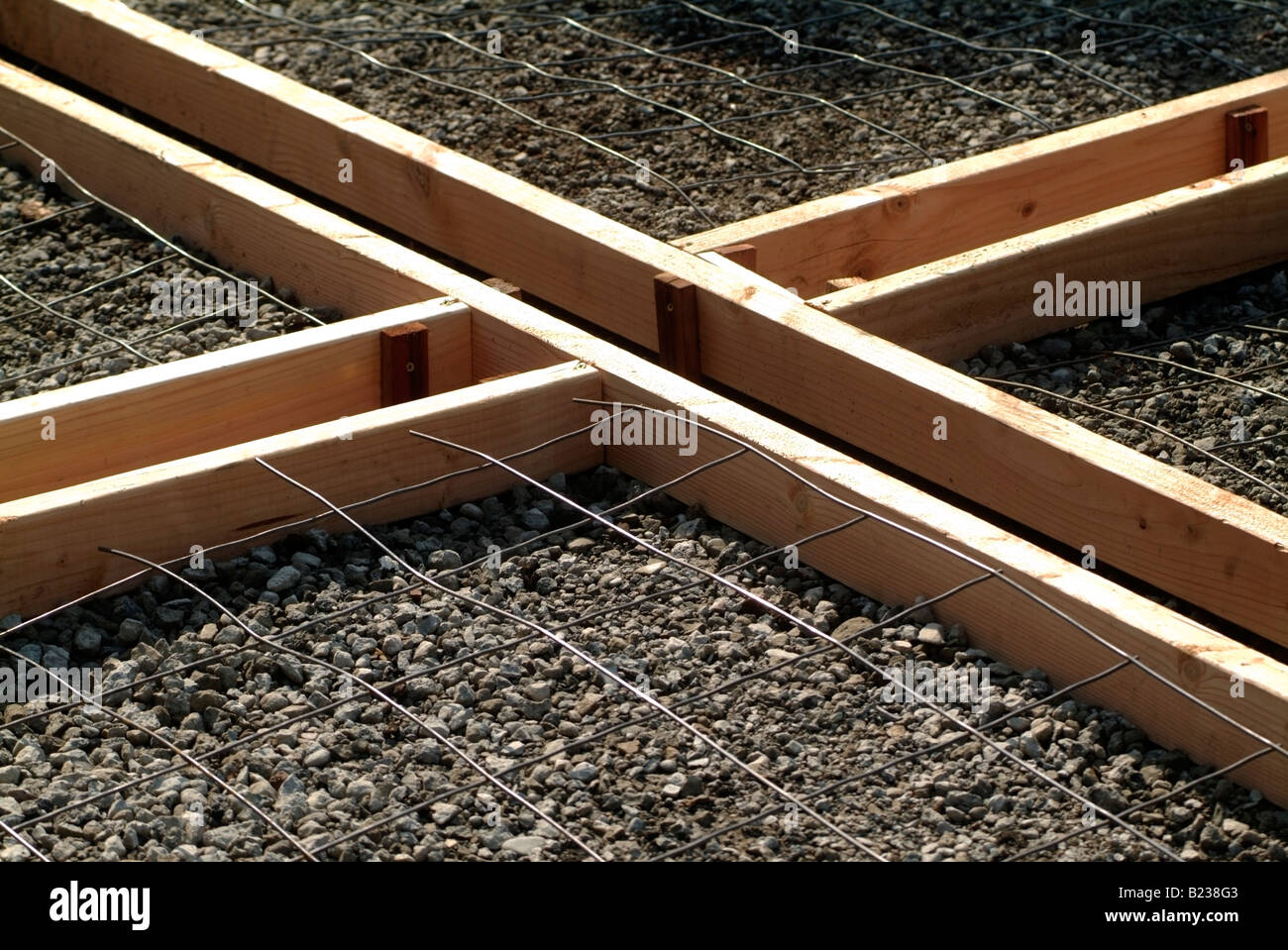 Wooden forms and rebar before concrete slabs are pored to make a patio at a private home in California. Stock Photo