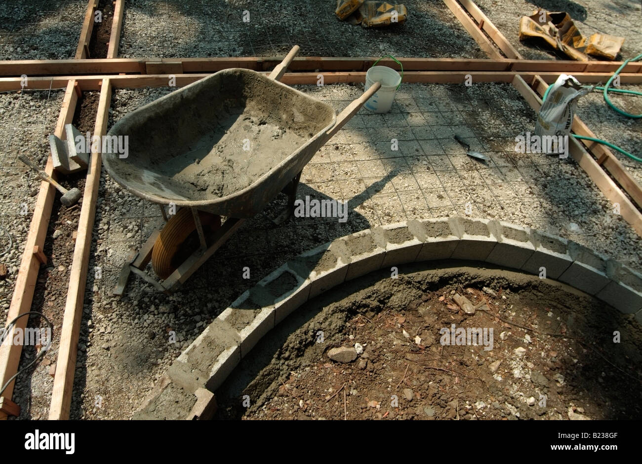 Wood forms, rebar and a masonry to form a step to a backyard patio of a private home in California. - Stock Image