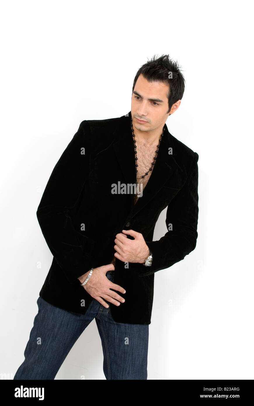 Young male fashion model against a white background Stock Photo