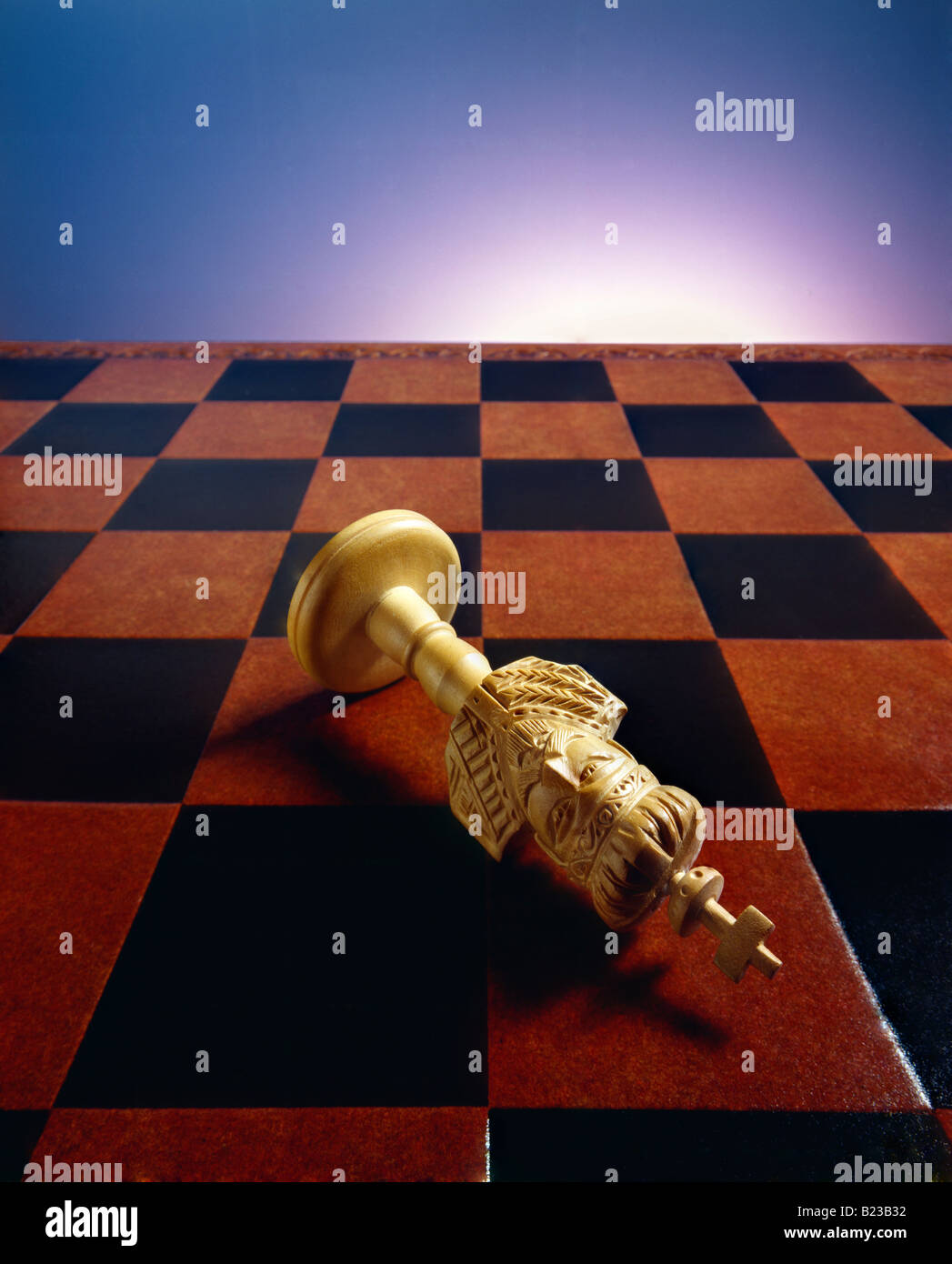 checkmate of fallen king on chessboard - Stock Image