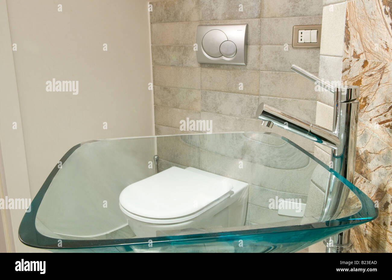 Italy, home interior, tiny bathroom, with glass sink, and toilet ...
