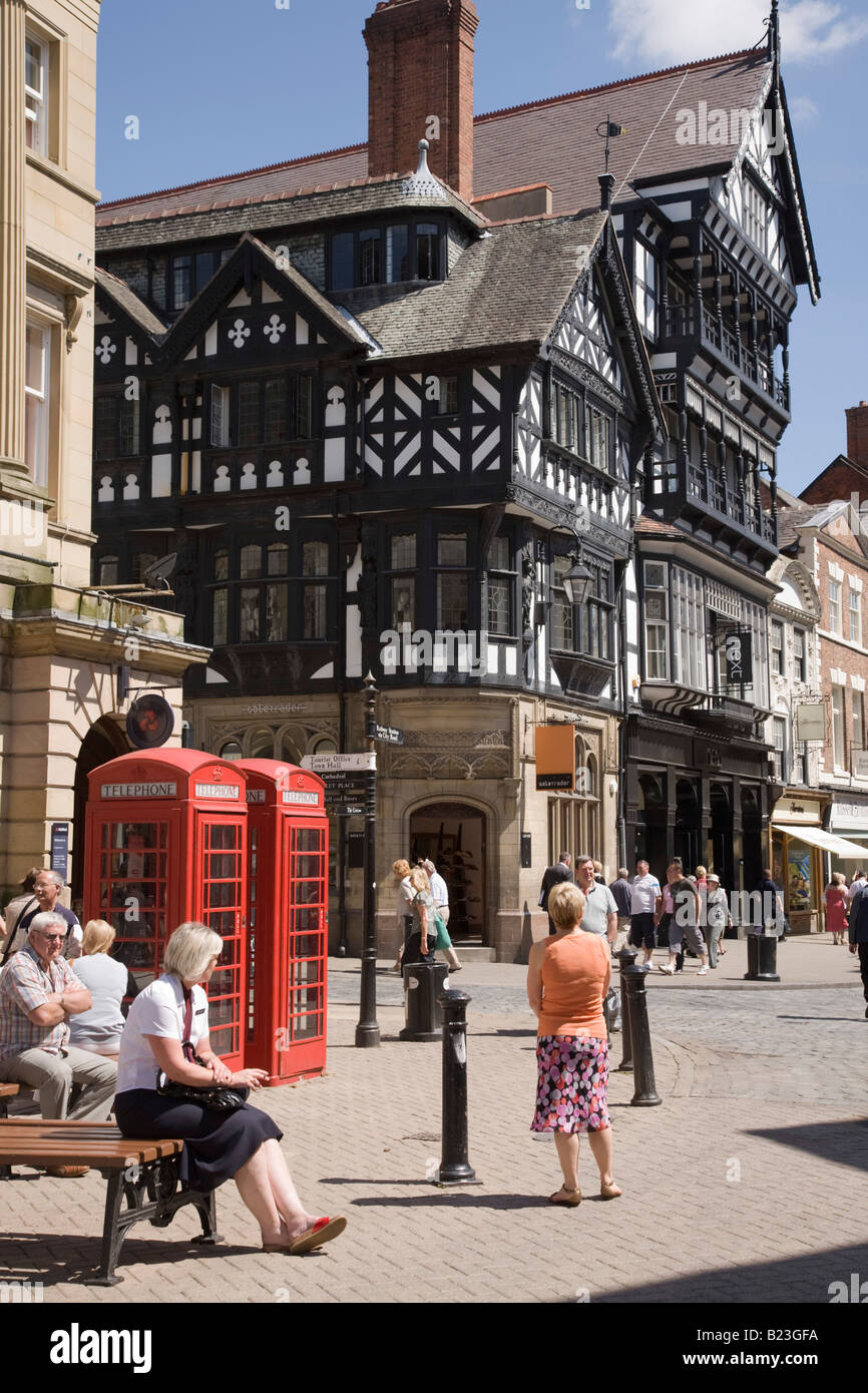Shoppers in Eastgate Street pedestrianised precinct in city centre. Chester Cheshire England UK Britain - Stock Image