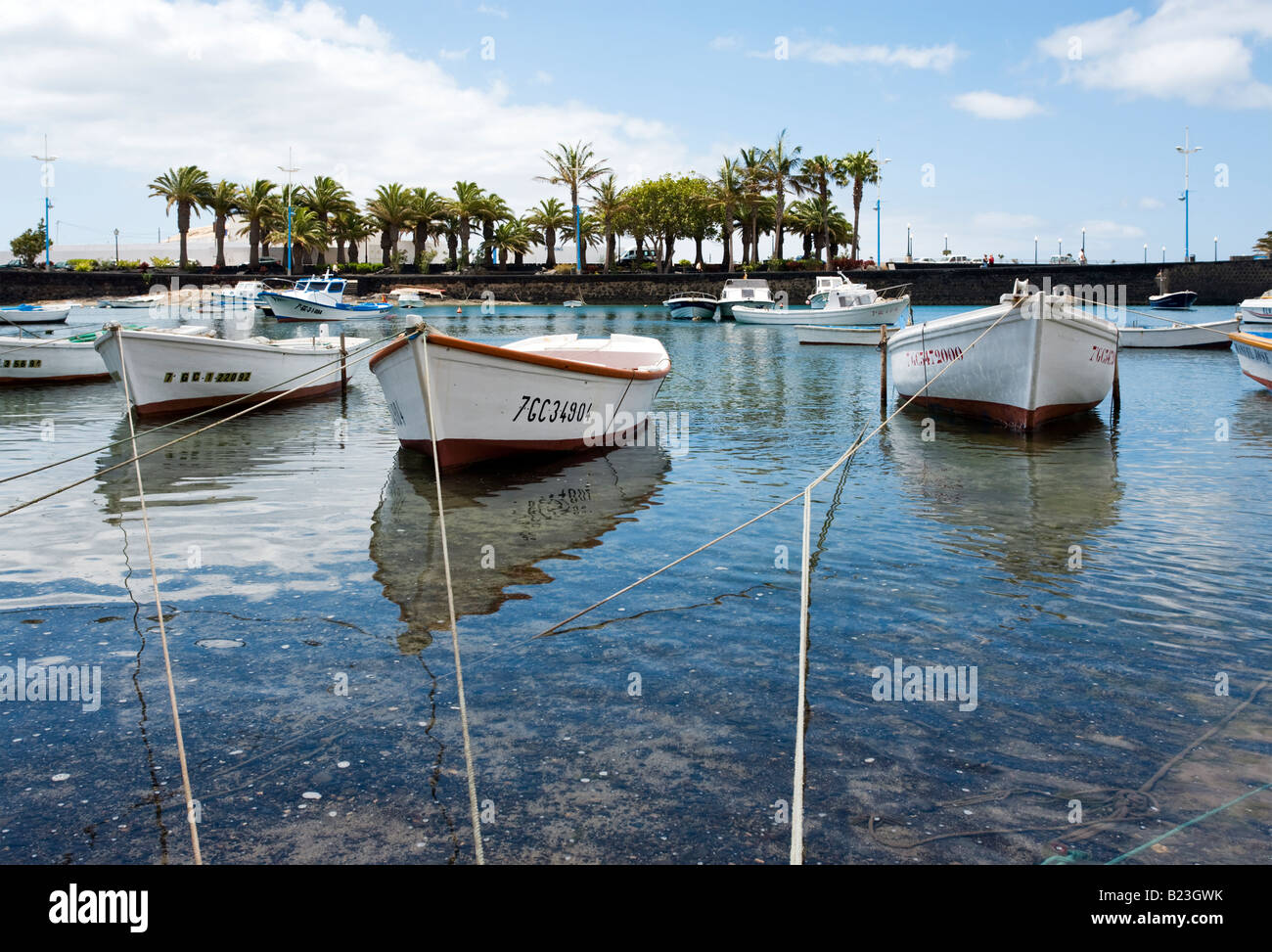 small fisher-boats anchored at the laguna Charco de San Gines, Arrecife, Lanzarote - Stock Image