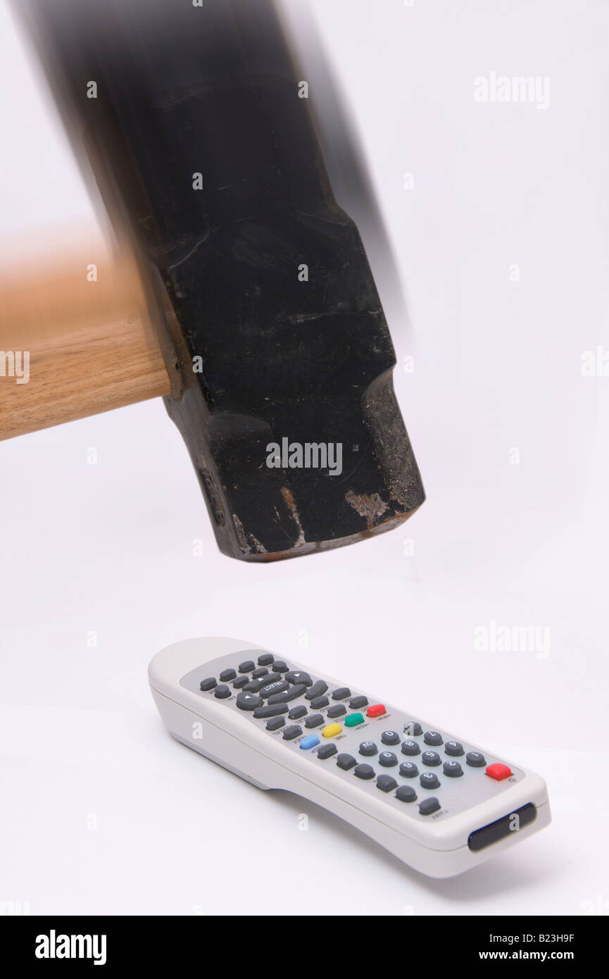 Remote control and hammer March 2008 - Stock Image