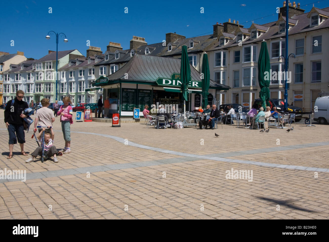 a diner with customers on the promenade aberystwyth mid wales - Stock Image