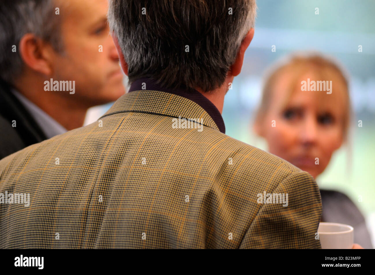 Royalty free photograph of a British business men in meeting talking in modern corporate offices London UK Stock Photo