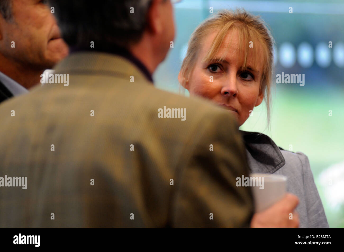 Royalty free photograph of a British business women in meeting talking in modern corporate offices London UK - Stock Image