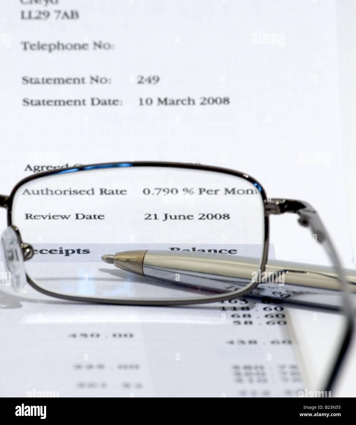 Bank statement viewed through glasses - Stock Image