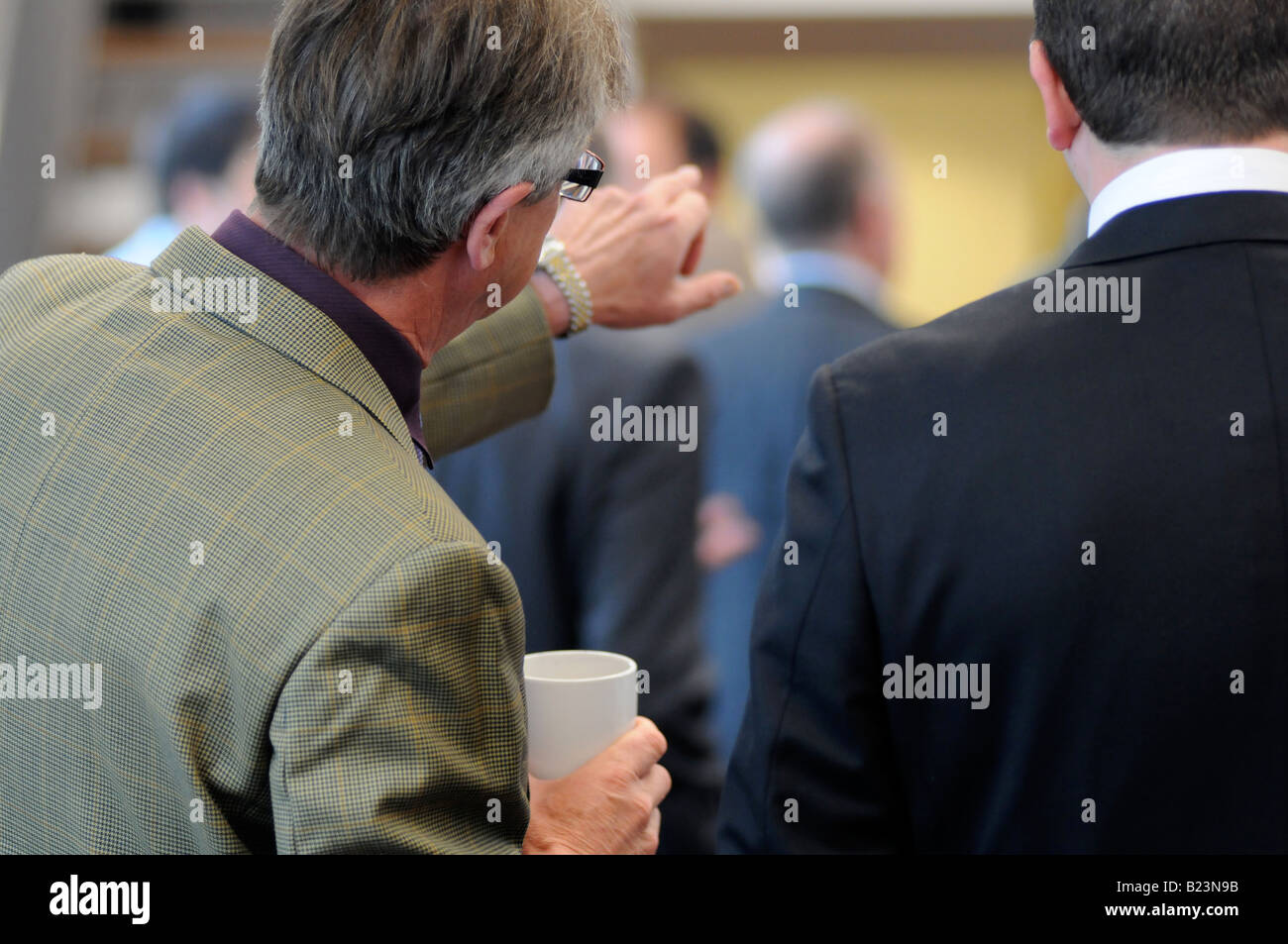 Royalty free photograph of a British business men in meeting talking and networking in corporate offices London Stock Photo