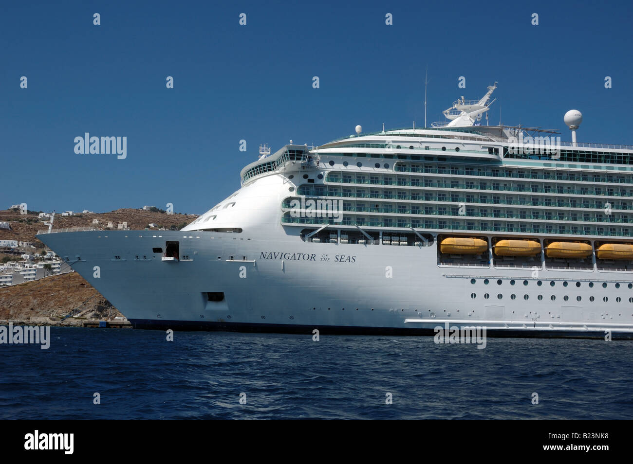 RCI cruise ship Navigator of the Seas moored in Mykonos, Greece - Stock Image