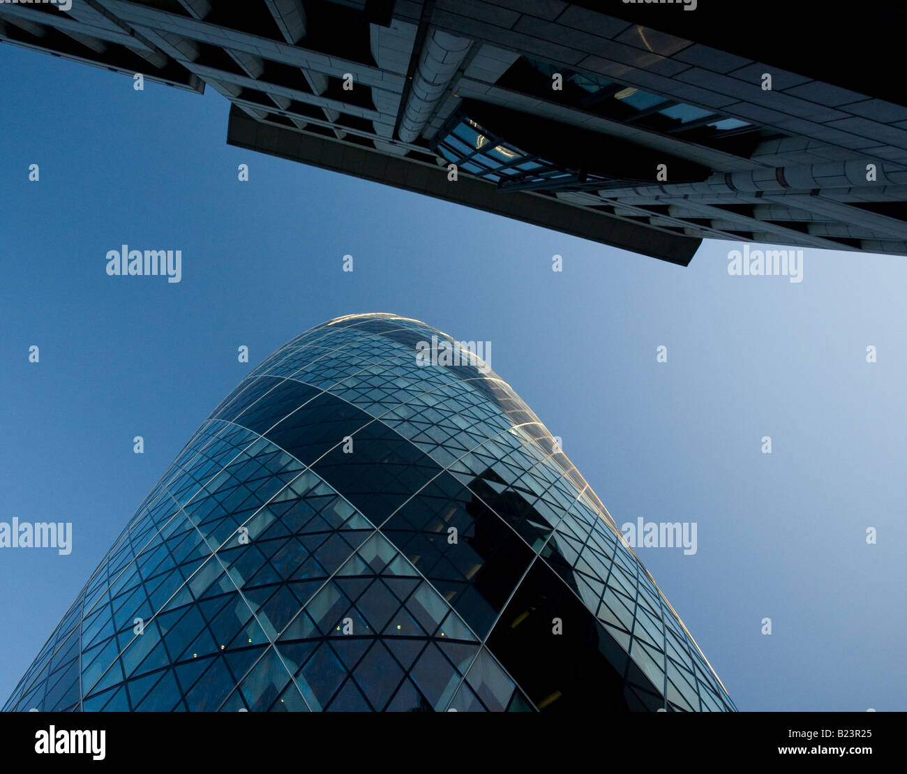Looking up at 30 St. Mary Axe, more commonly known as 'The Gherkin', in London. - Stock Image