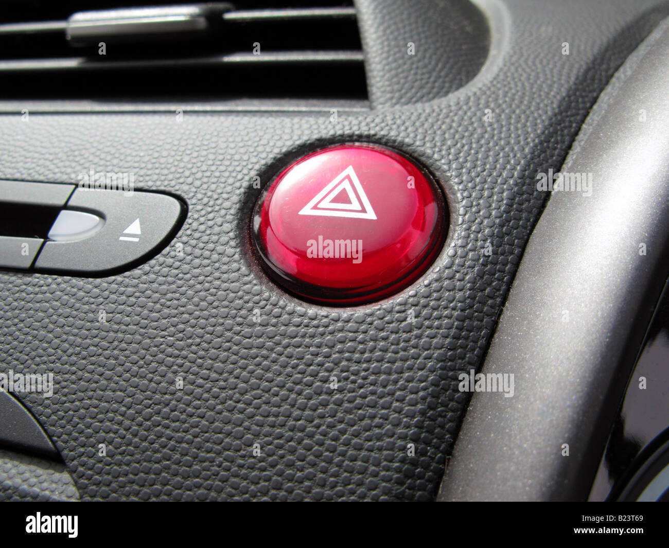 Red Hazard Warning Light Button On Dashboard Of Honda Civic   Stock Image