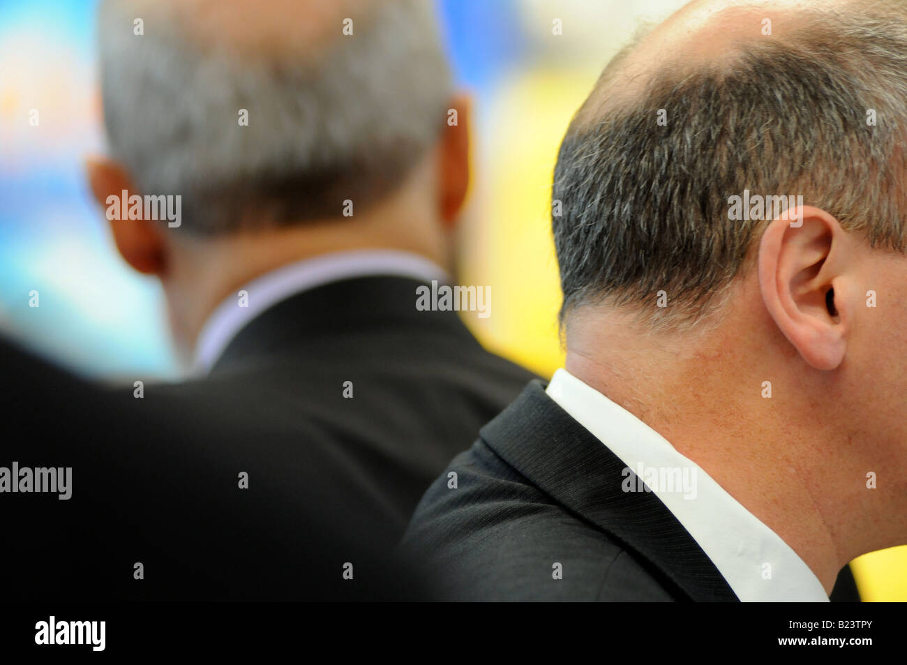 Royalty free photograph of a British business men in meeting talking in modern corporate offices London UK - Stock Image