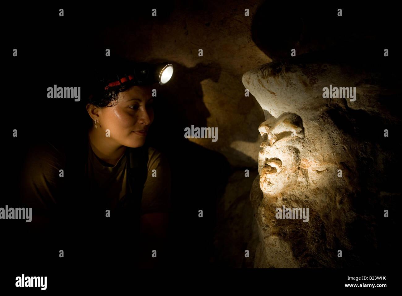 Mayan figure in underground cavern, Belize. - Stock Image