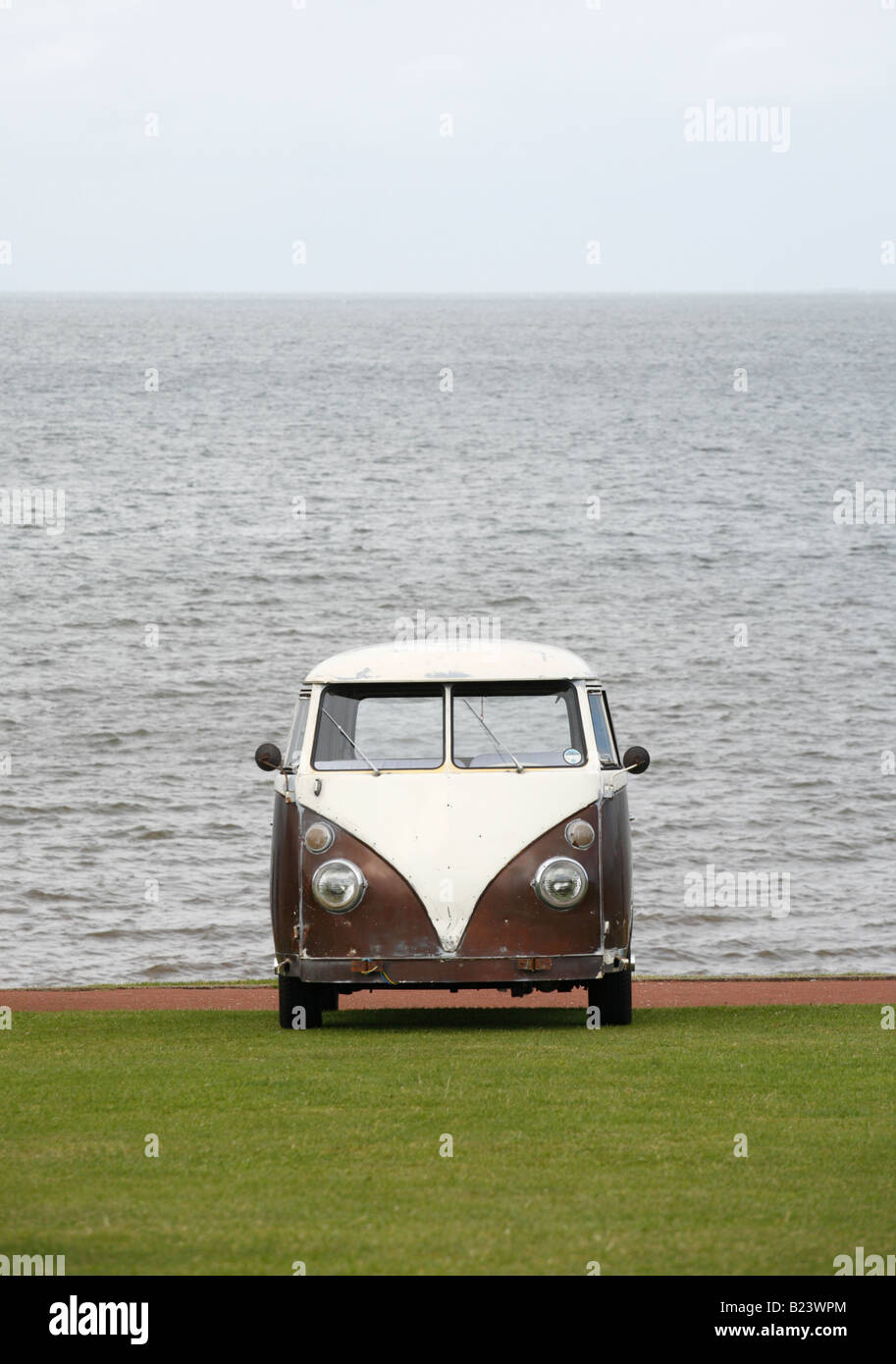 A VW camper van parked on a green at the seaside Hunstanton, England. - Stock Image