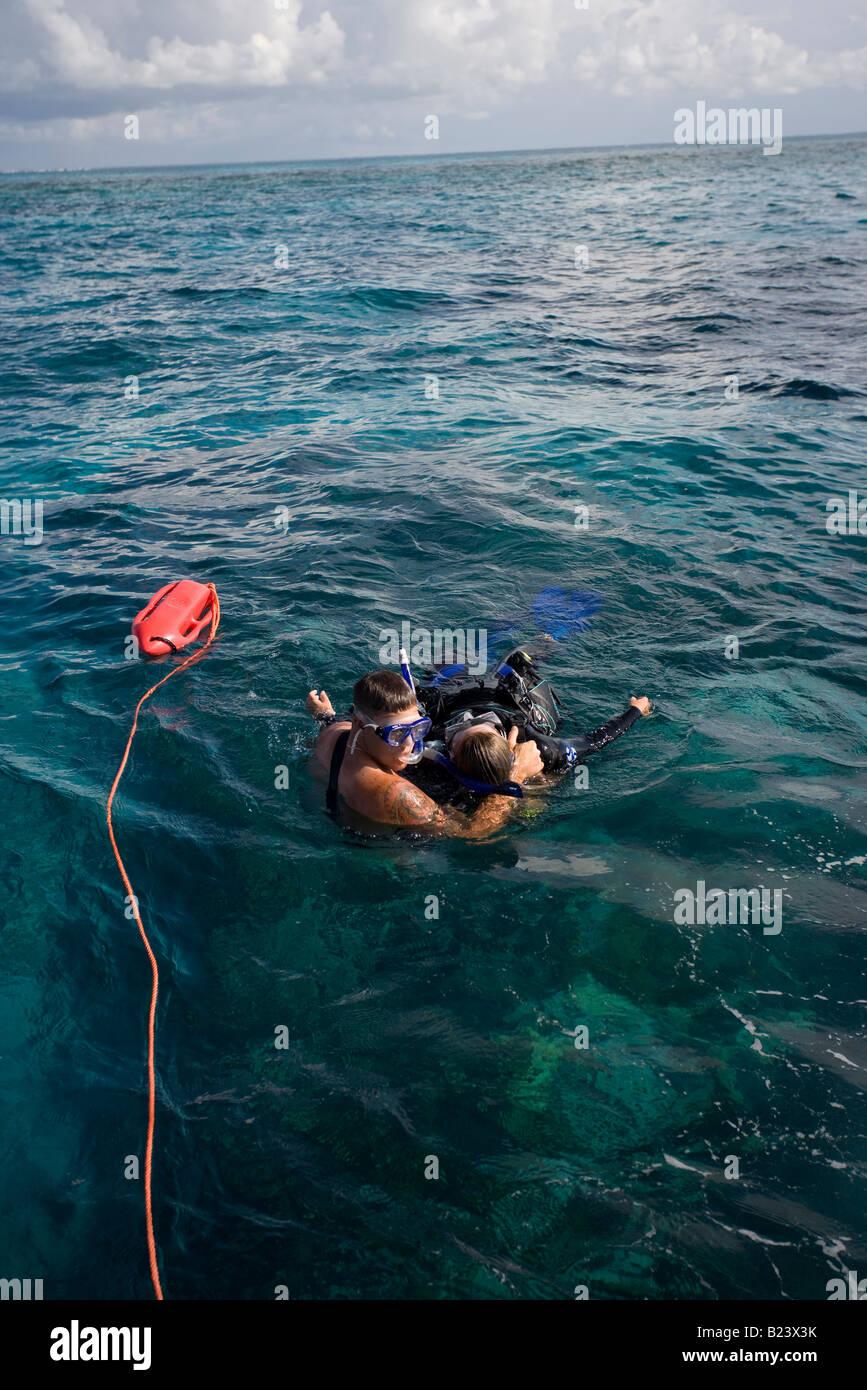 Rescue scenario with scuba diver. - Stock Image