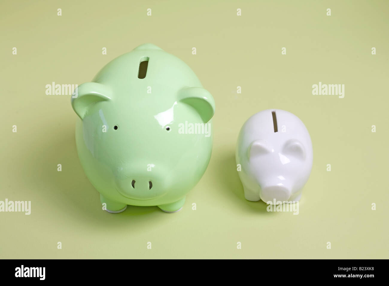 two piggy banks, one large and one small Stock Photo