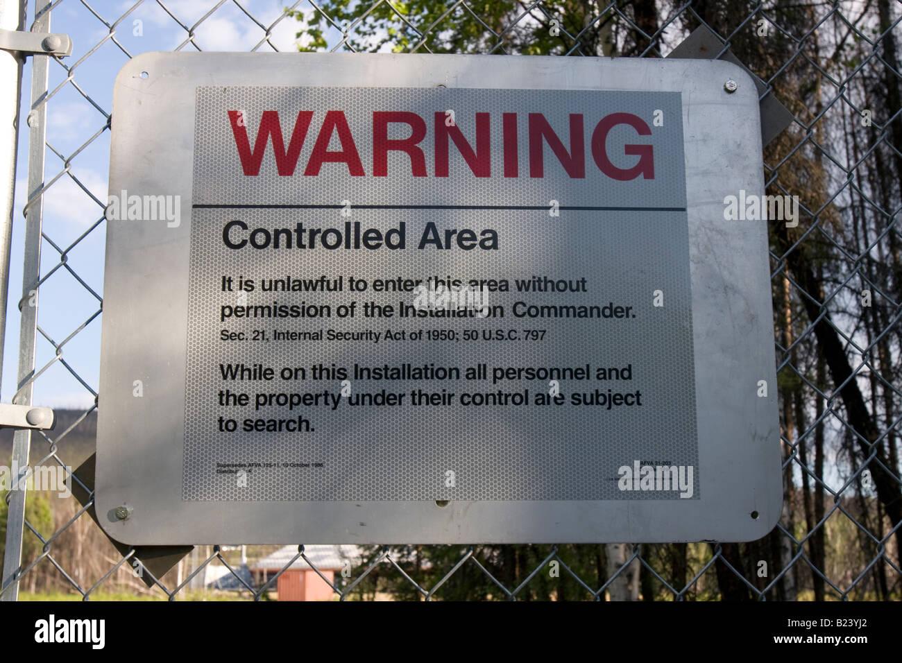 Warning sign on fence at Poker Flat Research Range, 30 mile Steese Highway, Fairbanks, Alaska - Stock Image