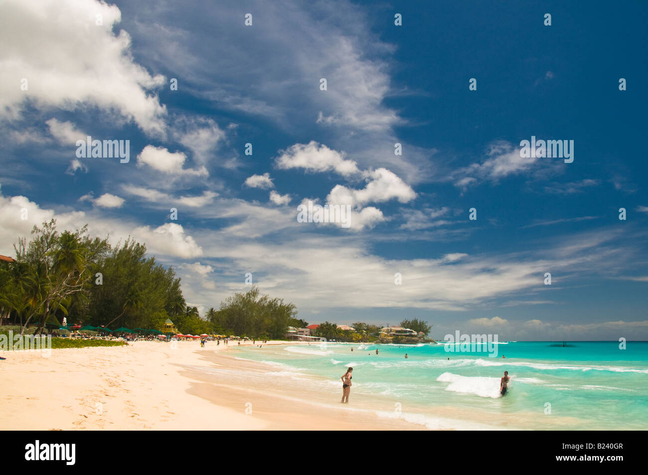 The blue sky white clouds and the turquoise waters a perfect beach setting at Rockley Beach in Barbados March 2008 - Stock Image