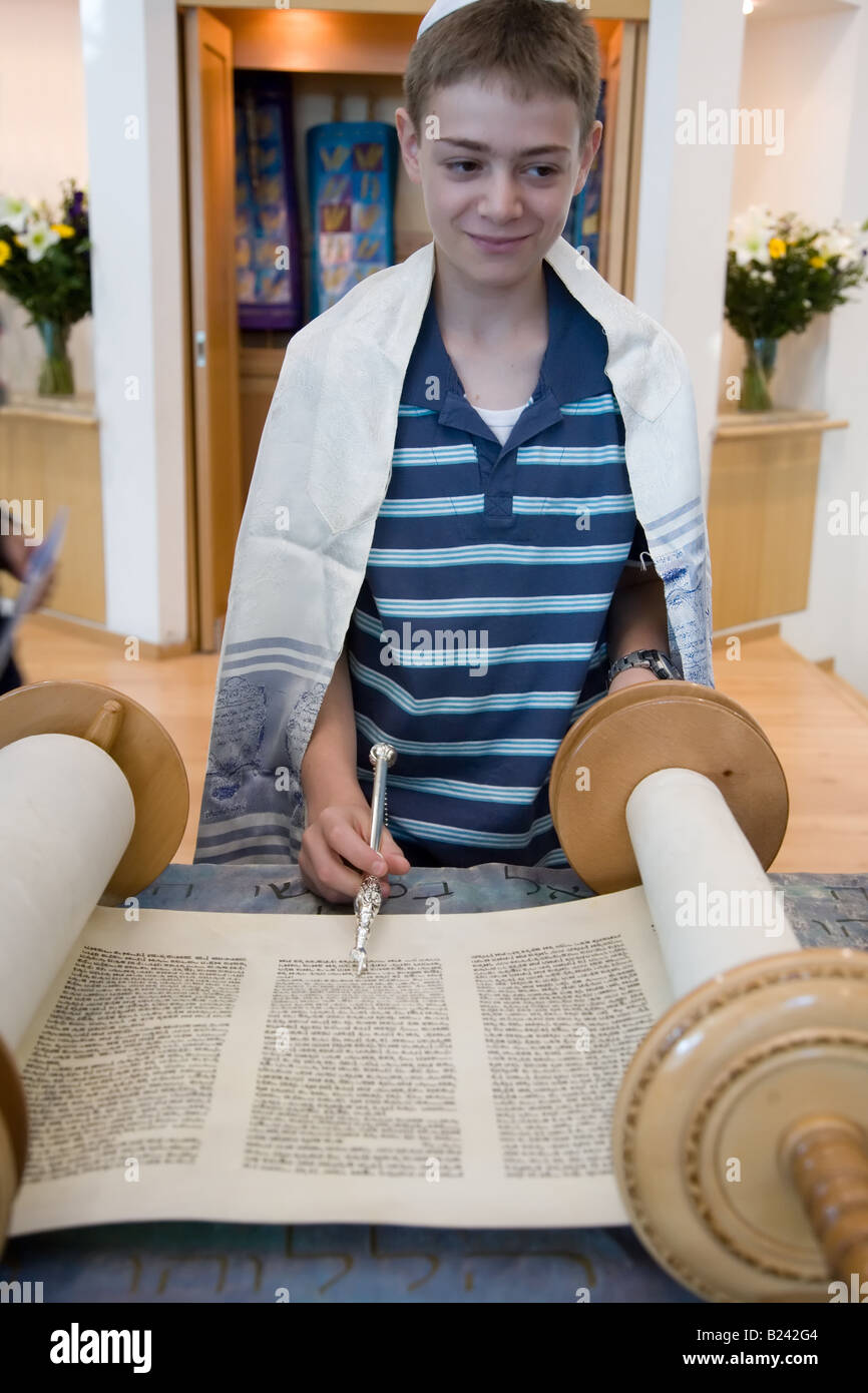Photo of 13 year Old Boy Reading From The Torah on His Bar-Mitzva - Stock Image