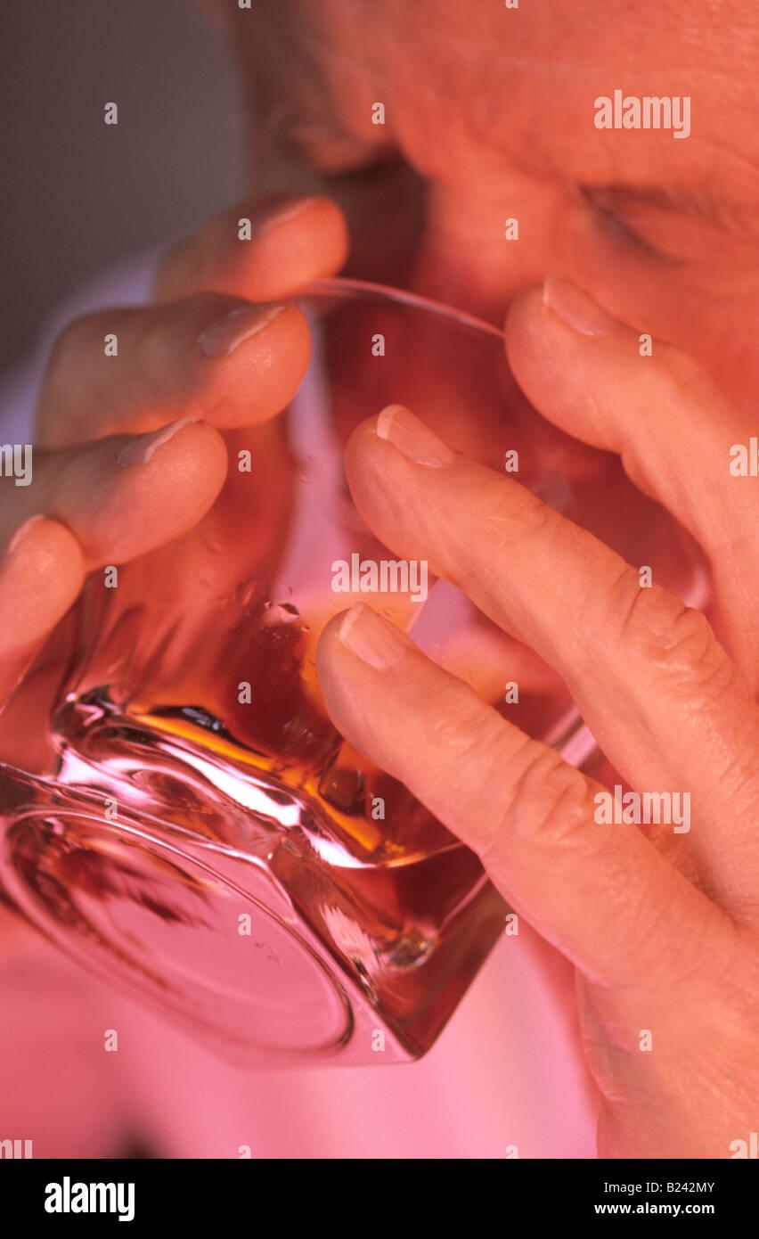 MAN DRINKING LIQUOR ALCOHOL CONSUMPTION - Stock Image