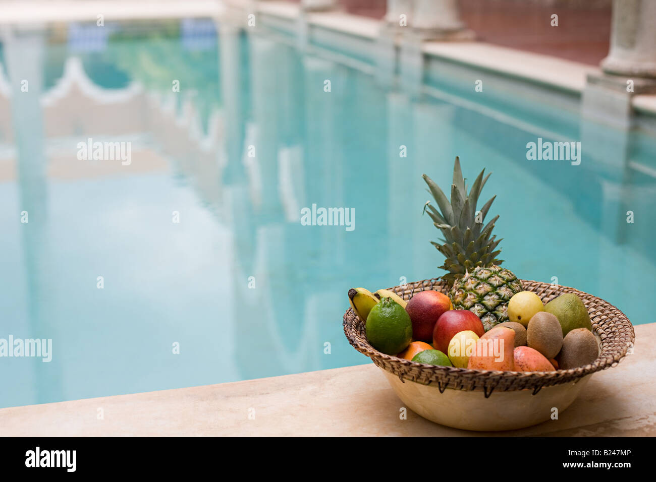 Fruit by swimming pool Stock Photo