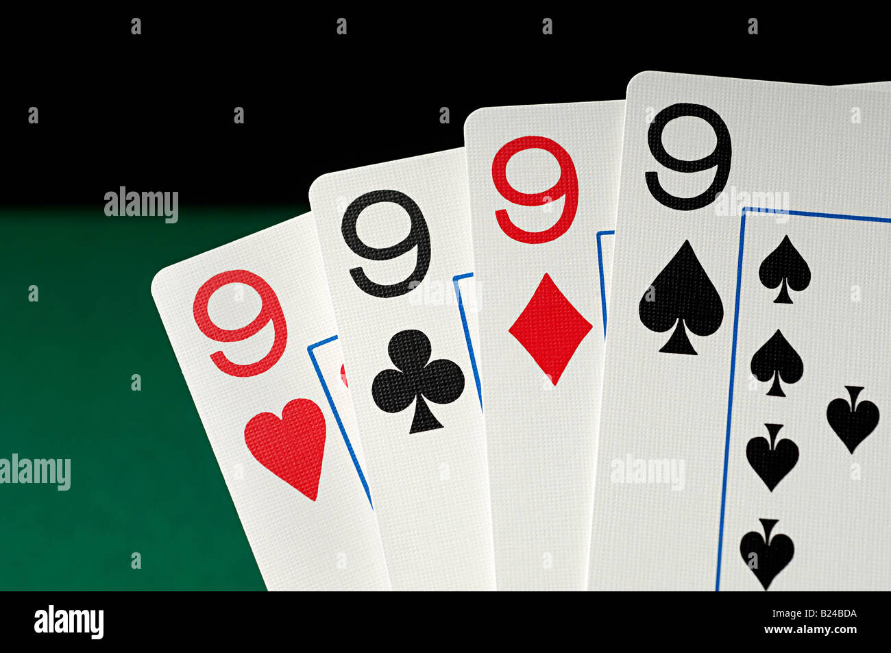 Four playing cards - Stock Image