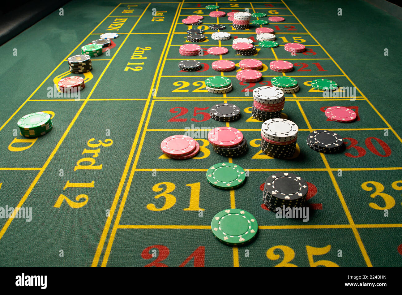 Gambling chips on a roulette table - Stock Image