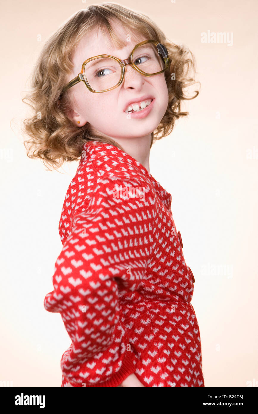 A geeky girl making faces - Stock Image