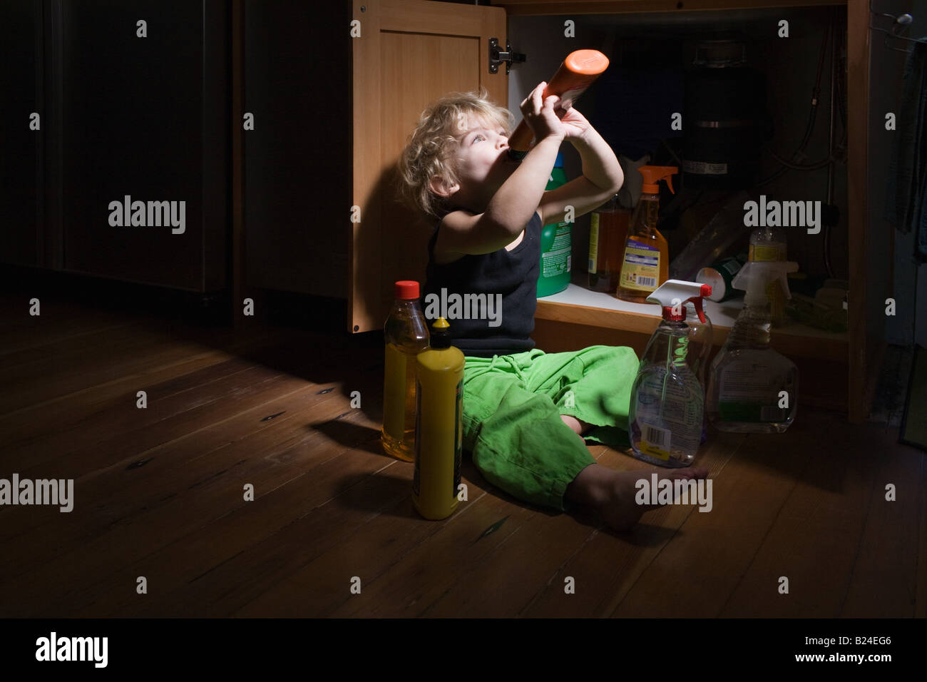 Boy drinking cleaning product Stock Photo