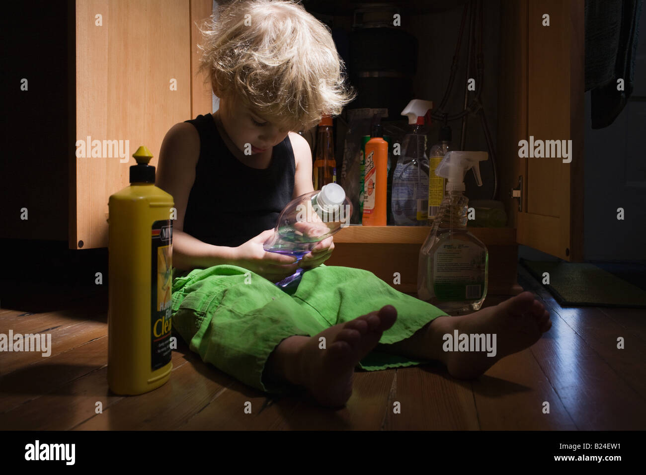 Little boy with cleaning products - Stock Image