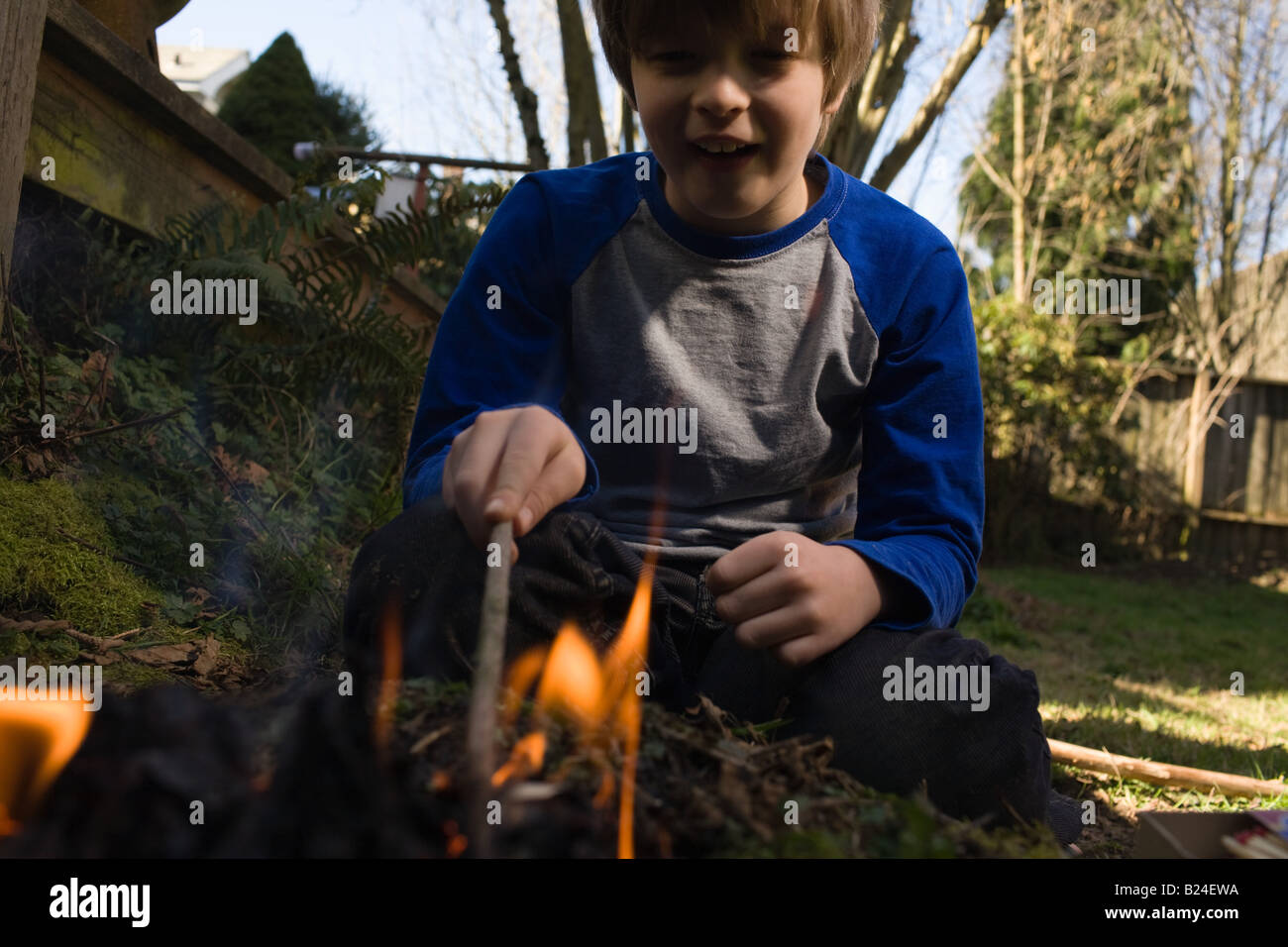 Boy playing with fire - Stock Image