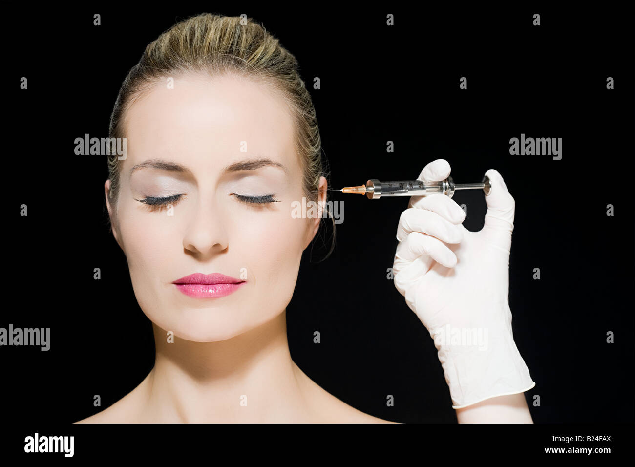 Woman having neurotoxin injection - Stock Image