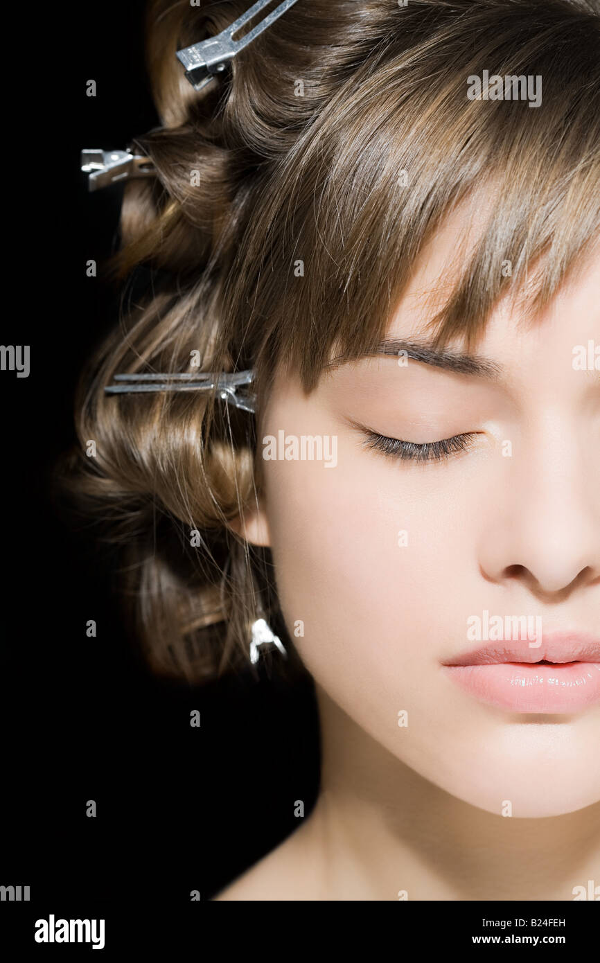 Woman with clips in her hair - Stock Image
