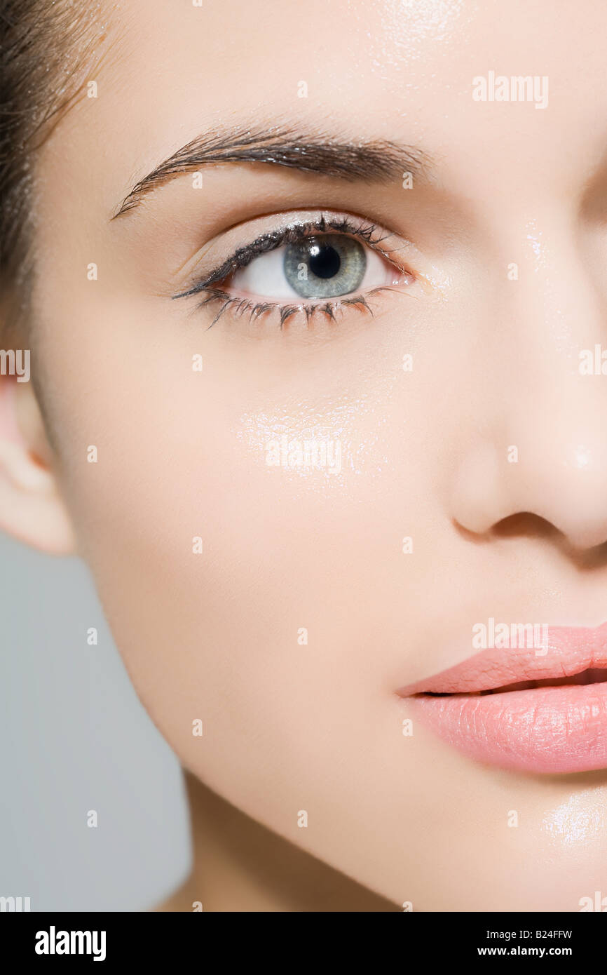 Woman with wet face - Stock Image