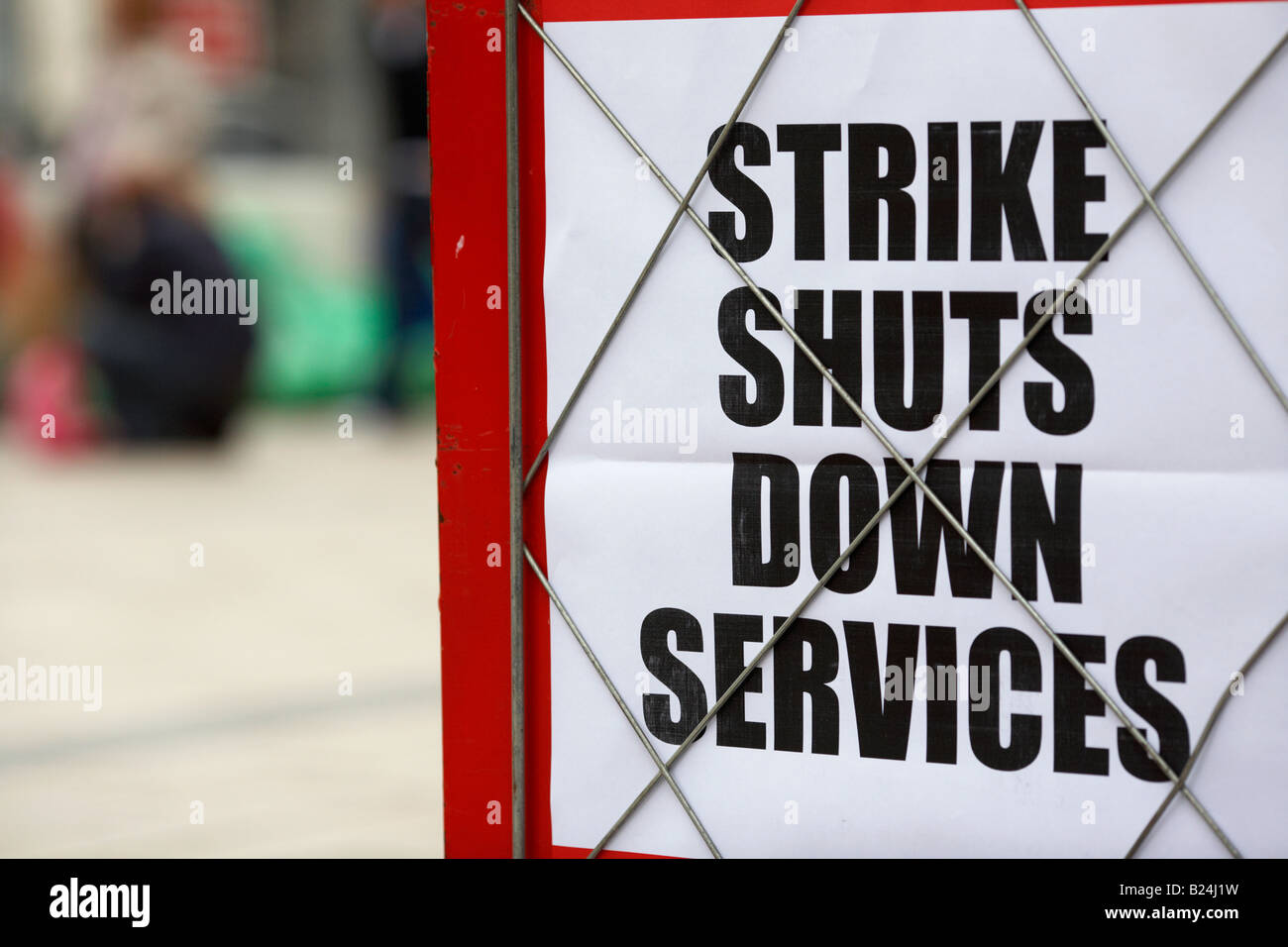 newspaper board headline about strike shutting down council services with refuse bags in the background in belfast - Stock Image