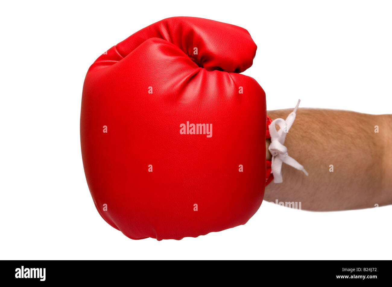 Red leather boxing glove delivering a punch shallow depth of field with focus on the glove on a white background - Stock Image