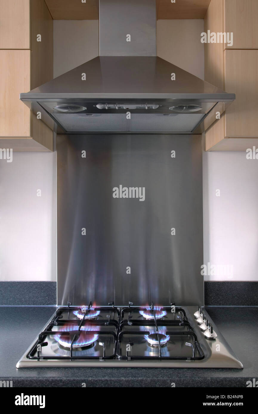 Modern steel kitchen gas hob and extractor hood - Stock Image