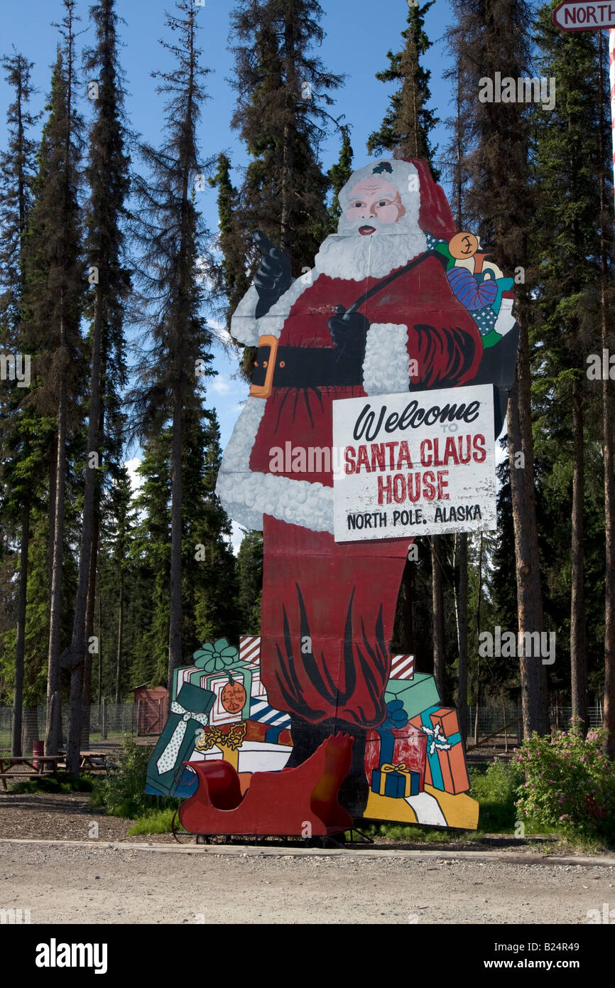 Statue of Father Christmas / Santa Claus standing besides his 'home'  in North Pole, Alaska. Stock Photo