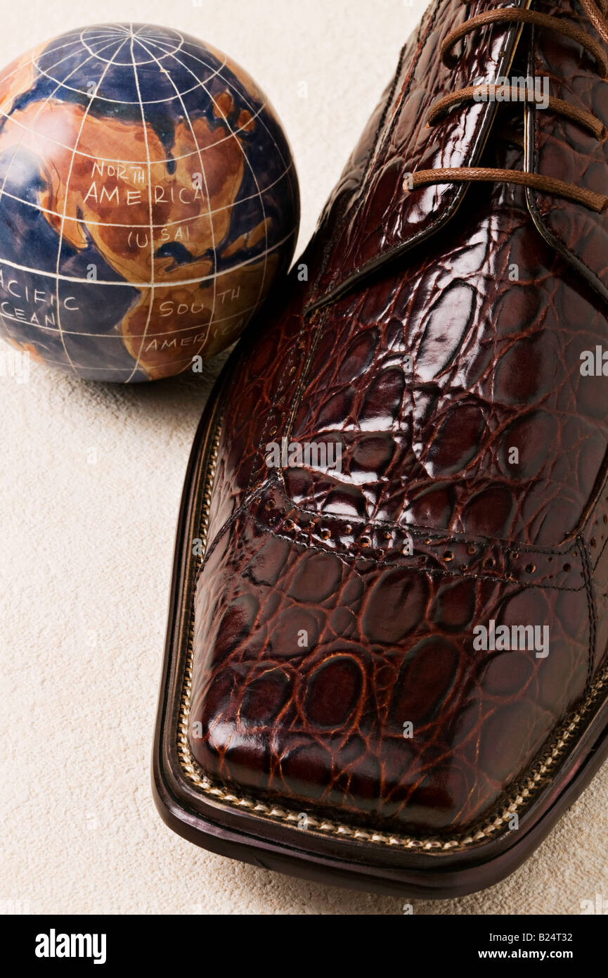 Man s dress shoe with globe - Stock Image