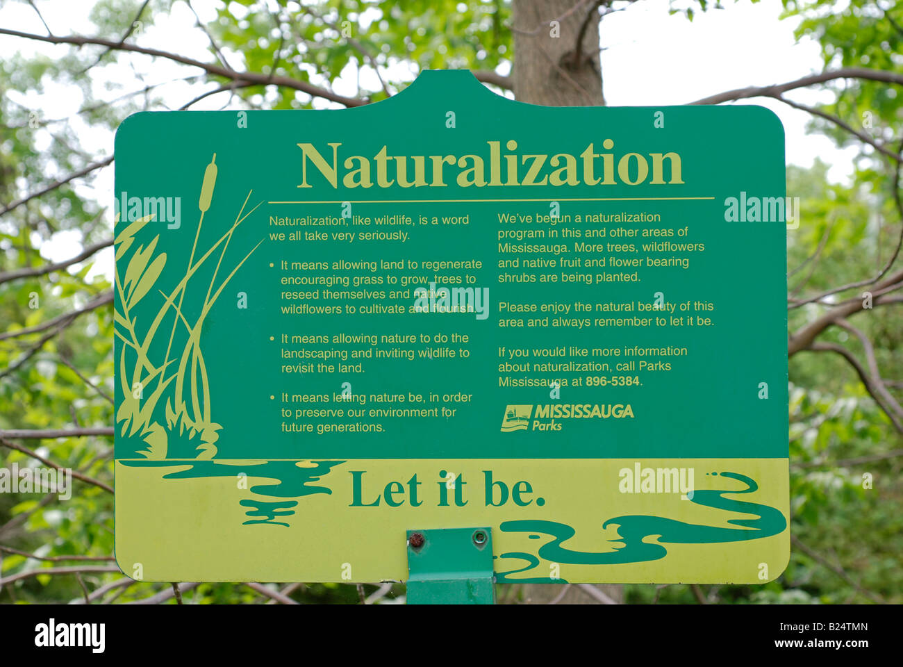 Naturalization Sign in a Mississauga Park - Stock Image