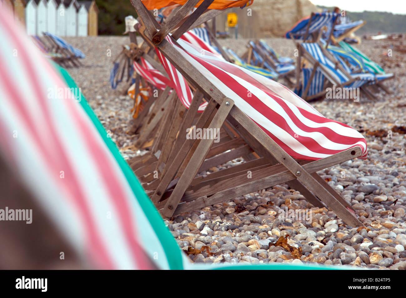 Deckchairs on the beach in Beer, Devon - Stock Image